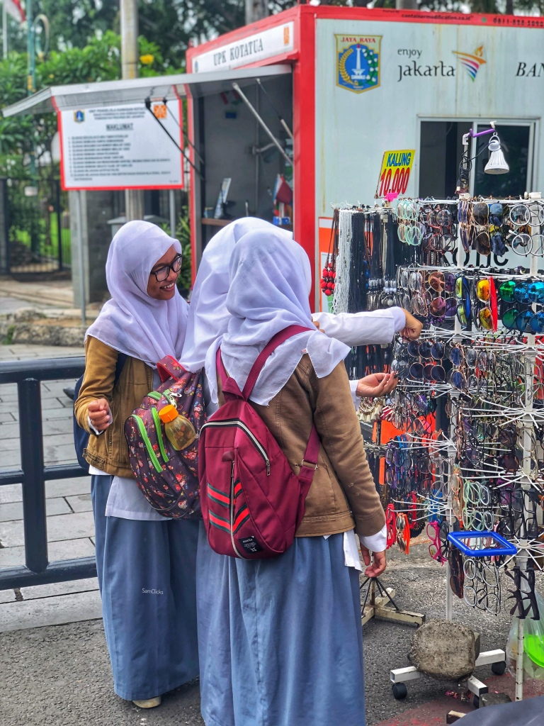 A picture of women shopping from street side vendors