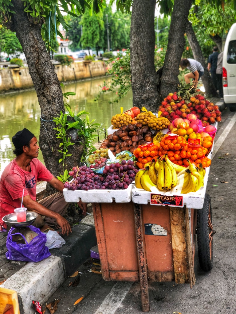 Fruit seller by the canal